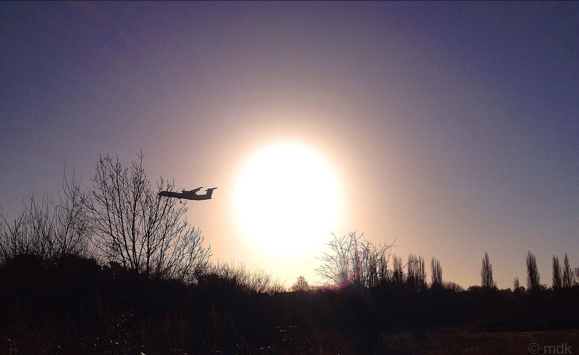 Low flying plane and sun, a distracting combination